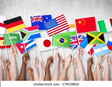Diversity of Hands Holding National Flags