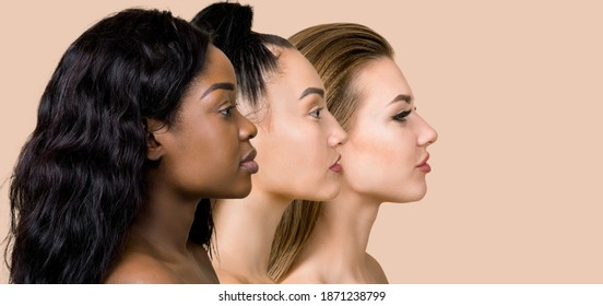 Diversity, multi-ethnic beauty concept. Three beautiful ladies of different races, African, Asian and Caucasian, with natural makeup, posing on the beige studio background in profile, standing in row - Shutterstock ID 1871238799