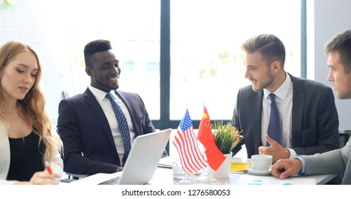 Diversity people talk the international conference partnership. American flag and Chinese flag.