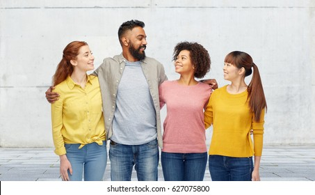 diversity, race, ethnicity, friendship and people concept - international group of happy smiling men and women over stone wall background