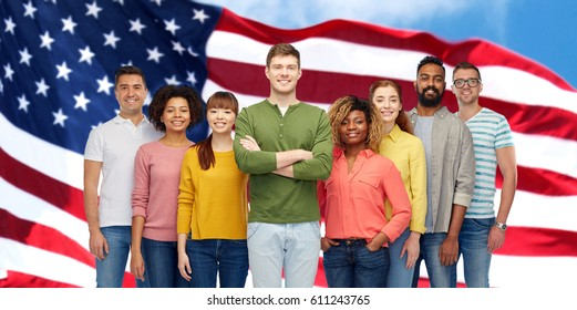 diversity, race, ethnicity, immigration and people concept - international group of happy smiling men and women over american flag background