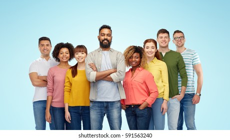 diversity, race, ethnicity and people concept - international group of happy smiling men and women over blue background