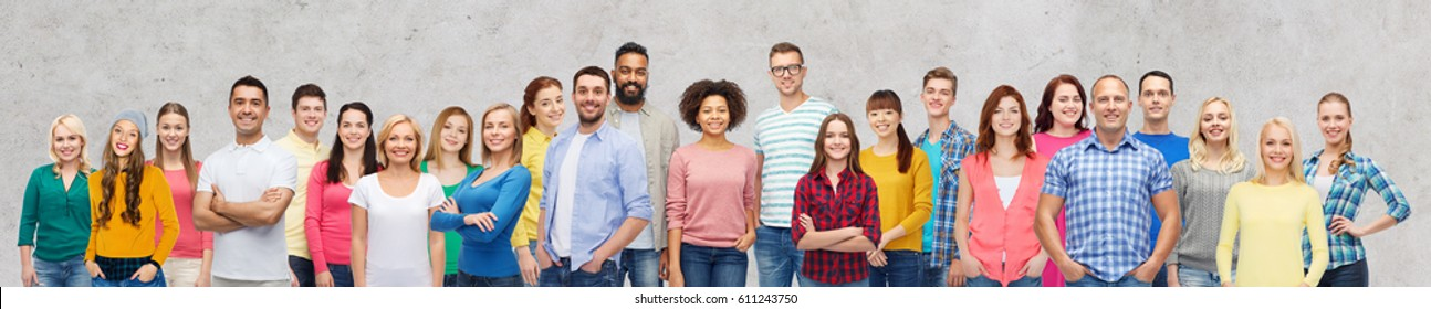 diversity, race, ethnicity and people concept - international group of happy smiling men and women over gray concrete background