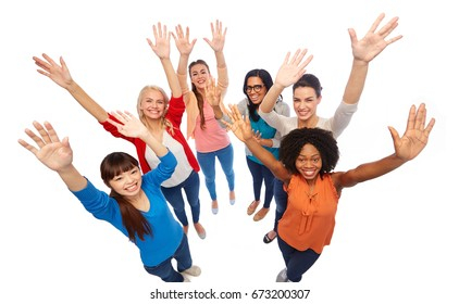 diversity, race, ethnicity and people concept - international group of happy smiling different women having fun over white