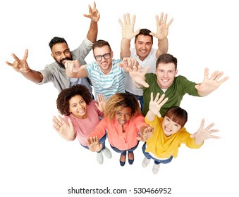 diversity, race, ethnicity, success and people concept - international group of happy smiling men and women celebrating victory over white
