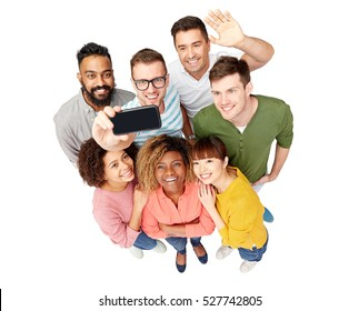 diversity, race, ethnicity, technology and people concept - international group of happy smiling men and women taking selfie by smartphone over white