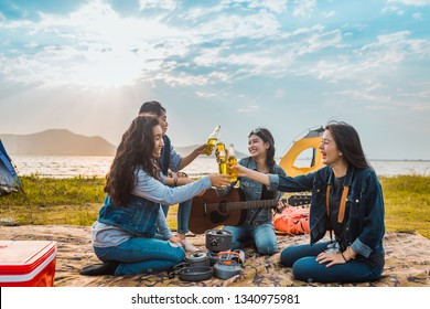 Diversity women party clink bottles enjoy camping,trekking,travel in vacation time relax.