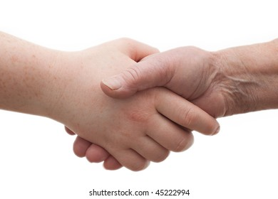 Diversity - young and old  shaking hands together