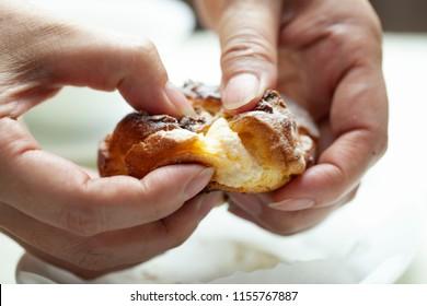https://image.shutterstock.com/image-photo/divide-cream-puff-hand-260nw-1155767887.jpg