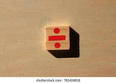 divide symbol on wood