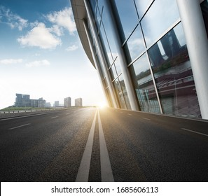 Divided highway passing through city buildings, blue nostalgia high contrast