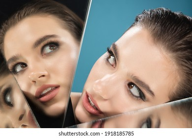 Divided. Portrait of young female fashion model with reflection on mirrors around her face. Beautiful caucasian woman with trendy make-up and well-kept skin. Style and beauty concept. Close up.
