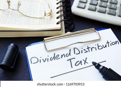 Dividend Distribution Tax DDT written on a sheet of paper.