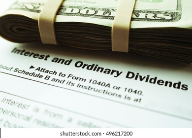 Dividends & Taxes Stock Photo High Quality