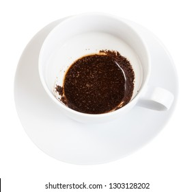 divination on coffee grounds - the rest of the coffee drink on the bottom of the white porcelain cup on saucer isolated on white background