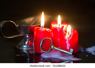 Divination and pouring wax with key and candle
