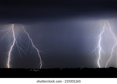 Divine Light, storm is coming, Sky with lightning bolt and silhouette of a cityscape