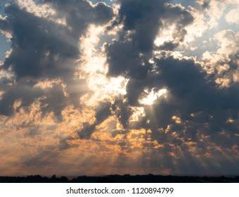 divine revelation in the form of the sun breaking the clouds with god rays visible