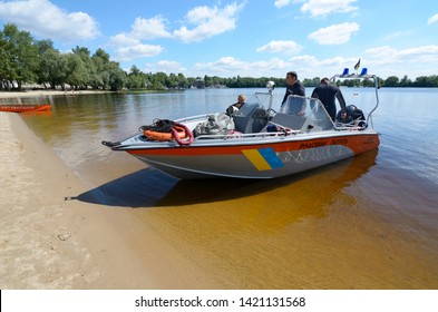 Diving boat floating on the Dnieper river with police lifeguards on duty and equipment aboard. June 12, 2018. Kiev, Ukraine