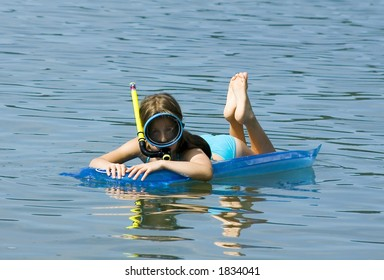 Diving girl in the blue sea