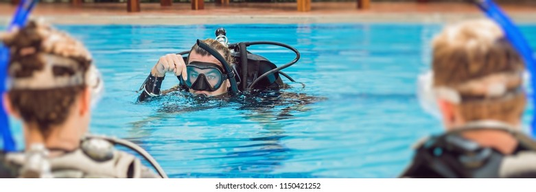 Diving instructor and students. Instructor teaches students to dive BANNER, long format
