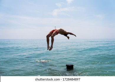 diving into the sea water backflip swandive cliff dive