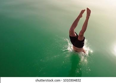 Diving and jumping from a boat at Balaton lake in Hungary