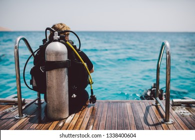 Diving lesson in open water. Scuba diver before diving into ocean.