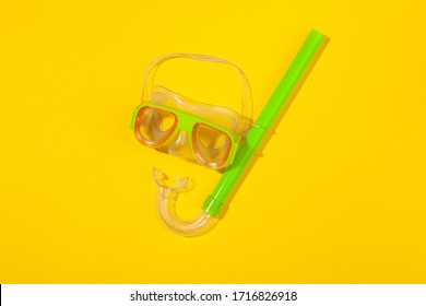 Diving mask on yellow background. Concept of beach holiday, sea tour, warm sunny summer. Advertising space