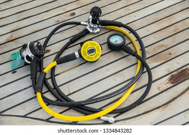 Diving regulators and mouthpiece on boat deck
