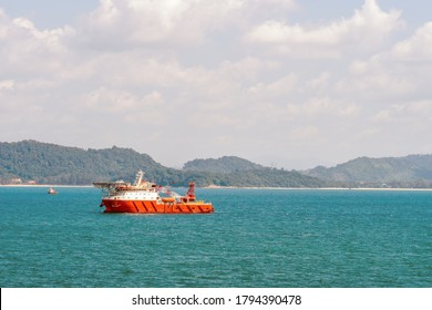 Diving support vessel anchored at outer port limit near shore