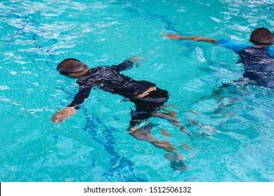 Diving training for children background, Swim training, Survival for children, stop drown background.