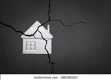The division of the property. The destruction of the family. A broken house. Divorce and division of property. A symbol of family problems. - Shutterstock ID 1885483420