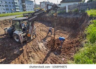 Divnogorsk, Russia - June 21: Construction of a house, The builder measures the depth of the well for the pile in Divnogorsk, Russia on June 21, 2017