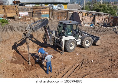 Divnogorsk, Russia - June 21: Construction of a house, drilling a well for bored piles in Divnogorsk, Russia on June 21, 2017