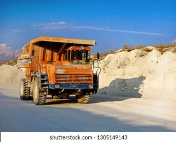 Divnogorye, Russia, August 2017: Dump track BelAZ carrying the industrial cargo and moving on the road inside the chalk quarry near the reserve Divnogorye