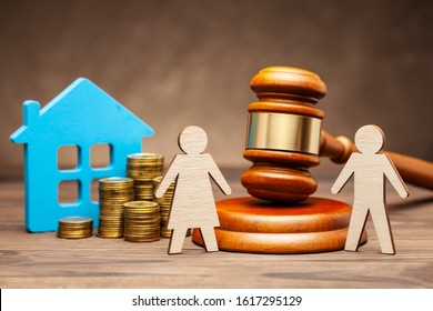 Divorce by law. Division of property after a divorce. The husband is trying to sue his wife for property under the law. A woman with a house and money, and a man with a hammer of a judge. - Shutterstock ID 1617295129