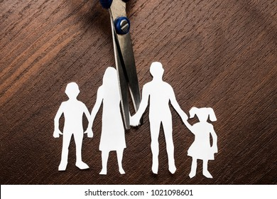 Divorce and child custody scissors cutting family apart.