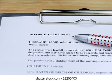 A Divorce contract on a lawyers desk along with a ball point pen for you to agree to.