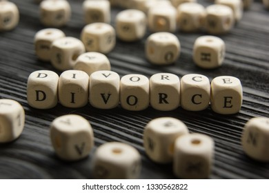 Divorce and separation concept. Two golden wedding rings, judge gavel. Dictionary definition