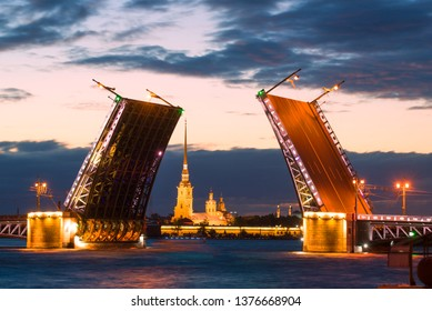 The Divorced Palace Bridge and the Peter and Paul Cathedral on a cloudy white night. Saint-Petersburg, Russia