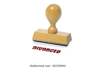 Divorced printed in red ink with wooden Rubber stamp isolated on white background