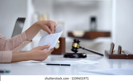 Divorced woman holding envelope with alimony, savings for single mom, allowance