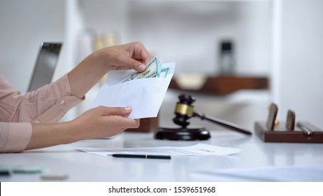 Divorced woman holding envelope with dollars, savings for single mom, allowance