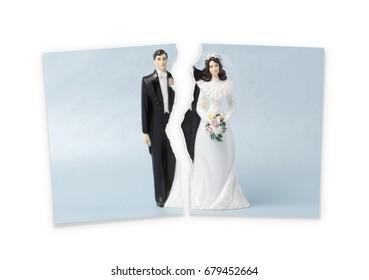 Divorce.Torn photograph of wedding cake topper