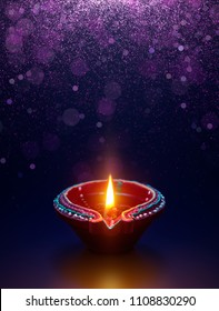 Diwali celebration - Diya lamp with glitter light background