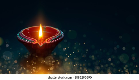 Diwali celebration - Diya lamp with magical particle