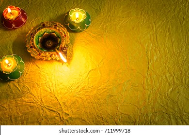 Diwali decorations with traditional Indian oil lamps with selective focus.