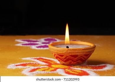 Diwali, Deepavali or Deepawali - the festival of lights, in India  Rangoli Diyas - colourful and  lit in night.