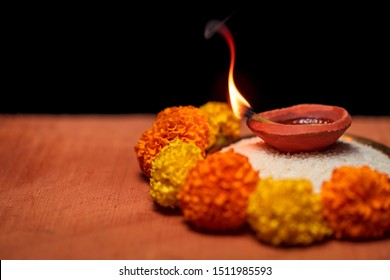 Diwali Diya, oil lamp beautifully decorated on the festive occasion of deepavali, deepawali. Beautiful stock photo with copy space of diwali diya for background concept.